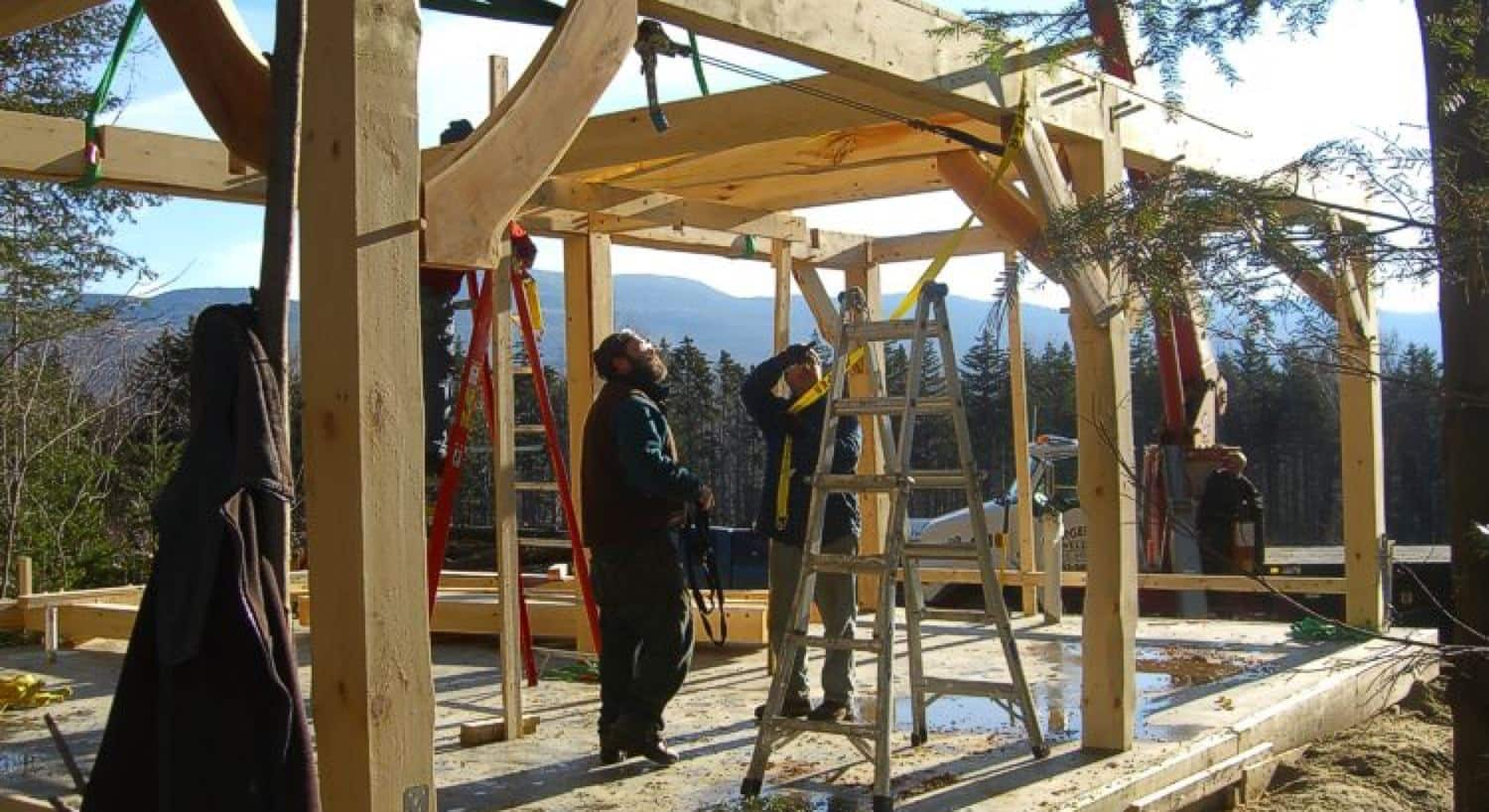 Two men constructing a cabin in the winter time