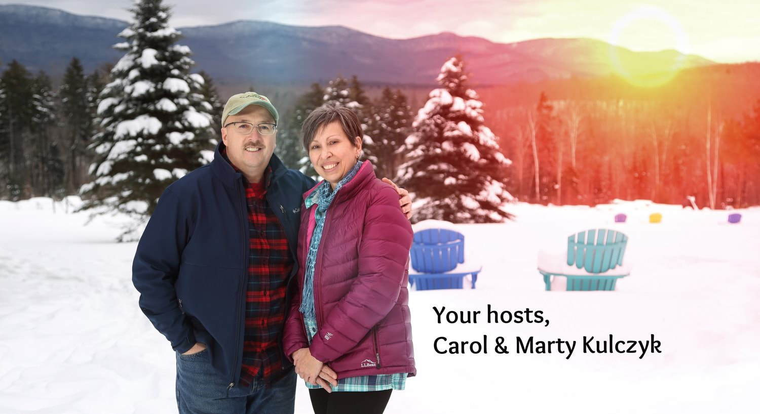 Owners Carl & Marty Kulczyk standing outside amidst snow-covered ground and trees and the sun setting behind the distant hills